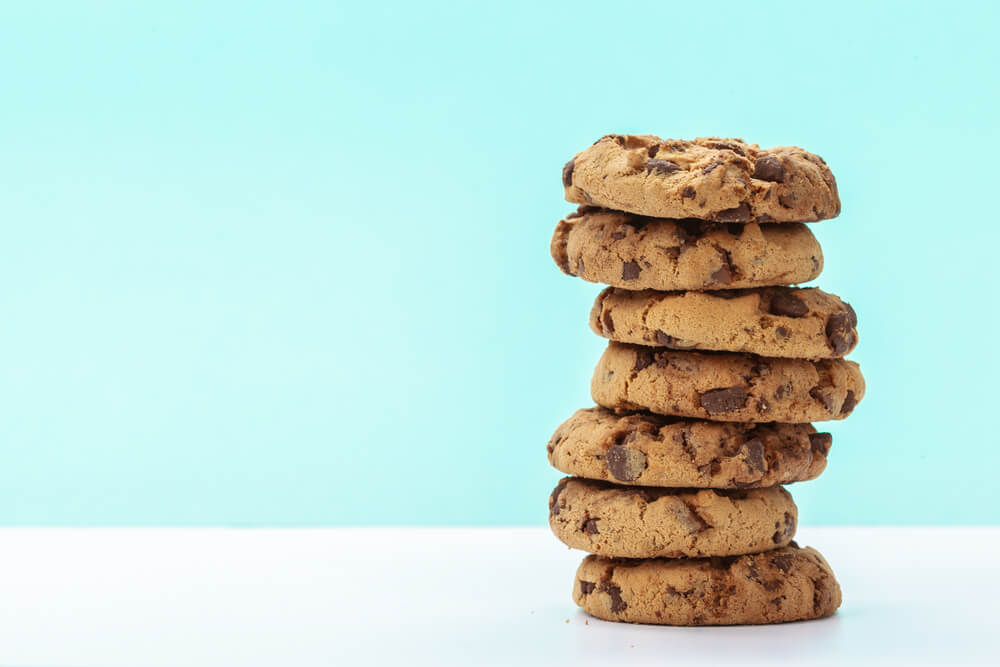 chocolate chunk cookies on a bright blue background