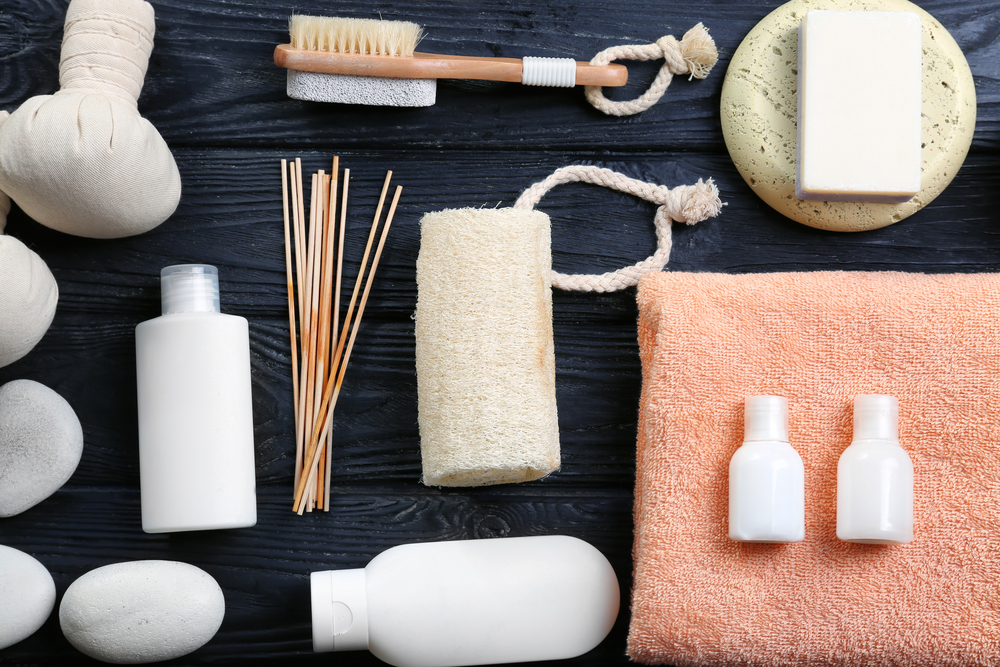 Towel and bathroom products on wooden background