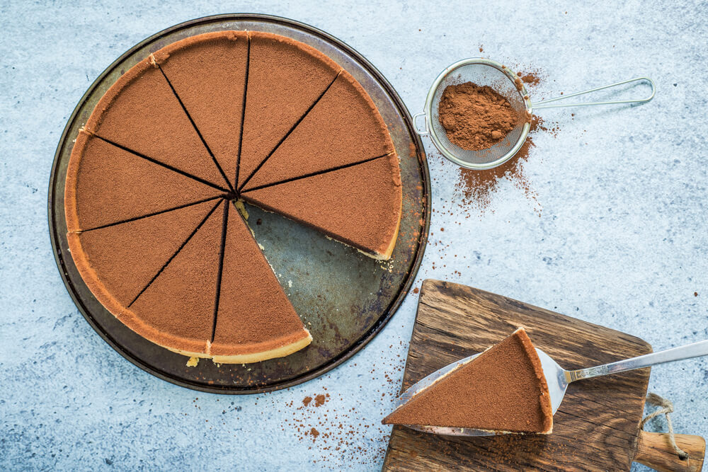 overhead view of a chocolate torte sliced for sharing