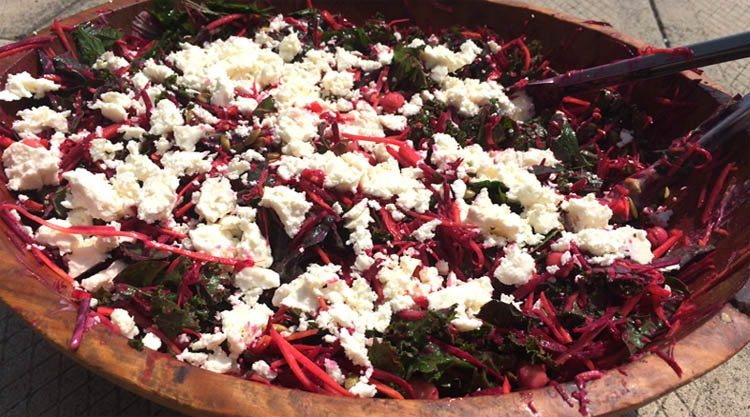 top view of beet and cheese salad in a large wooden bowl