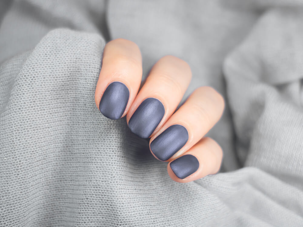 matte grey manicure on hands