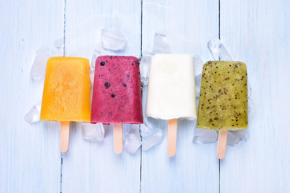 top view of homemade popsicles from fruits