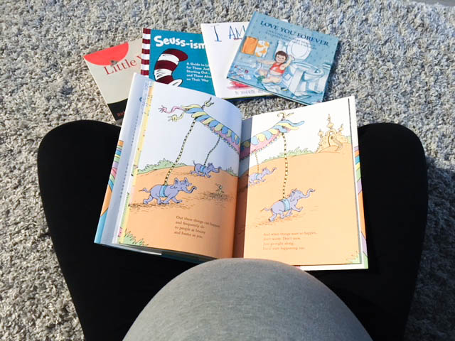 Expecting mama reading Dr. Seuss