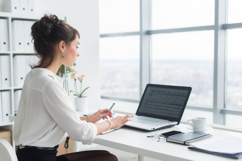 Woman at the workplace with notebook laptop