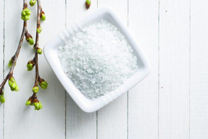 bath salt on white wood table