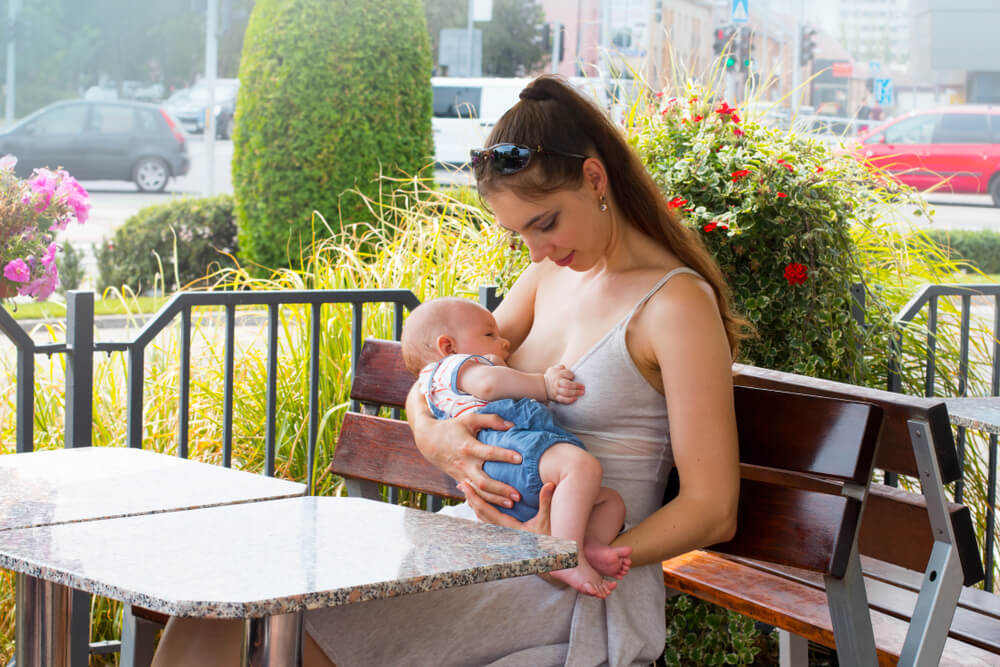 woman breastfeeding in public