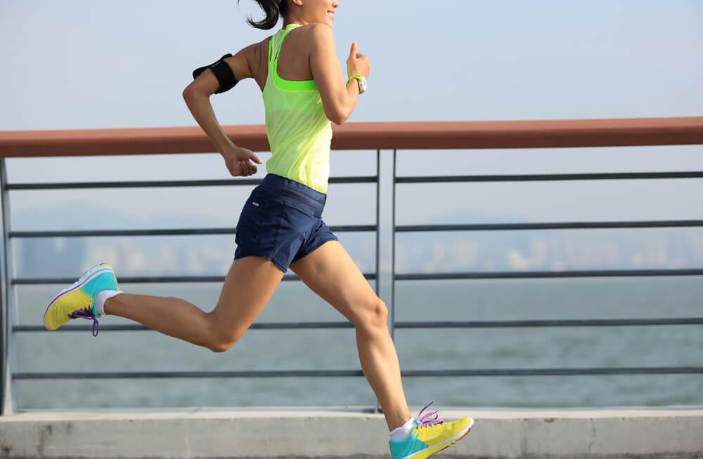 woman runner running at seaside