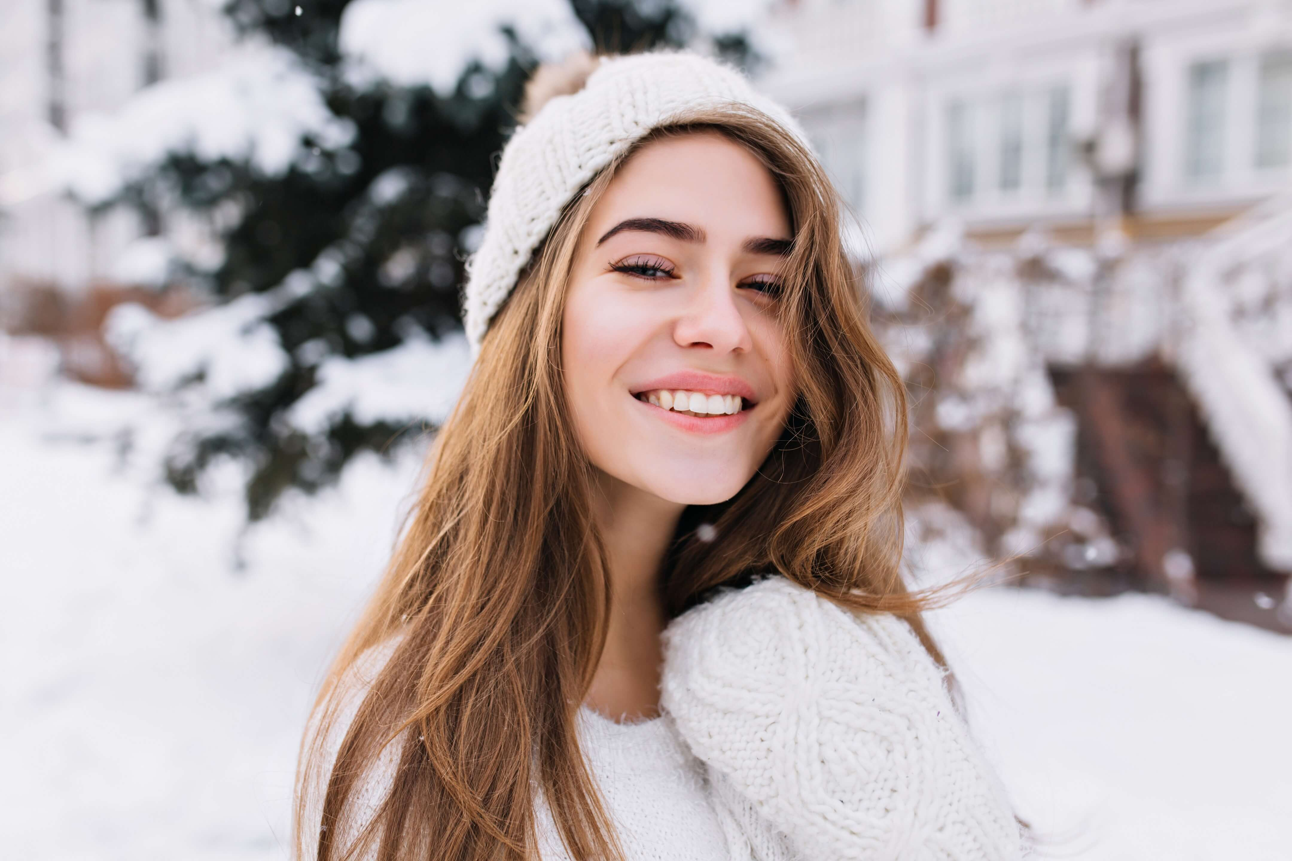 Girl with long hair outside in winter with snow