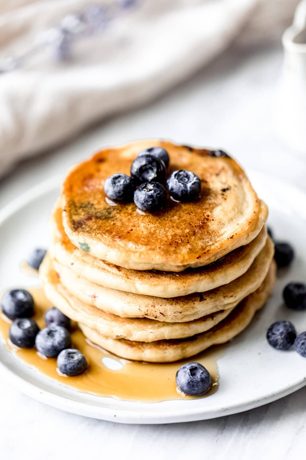almond flour pancakes with blueberries on top