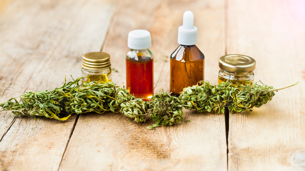 Cannabis oil bottles and flowers