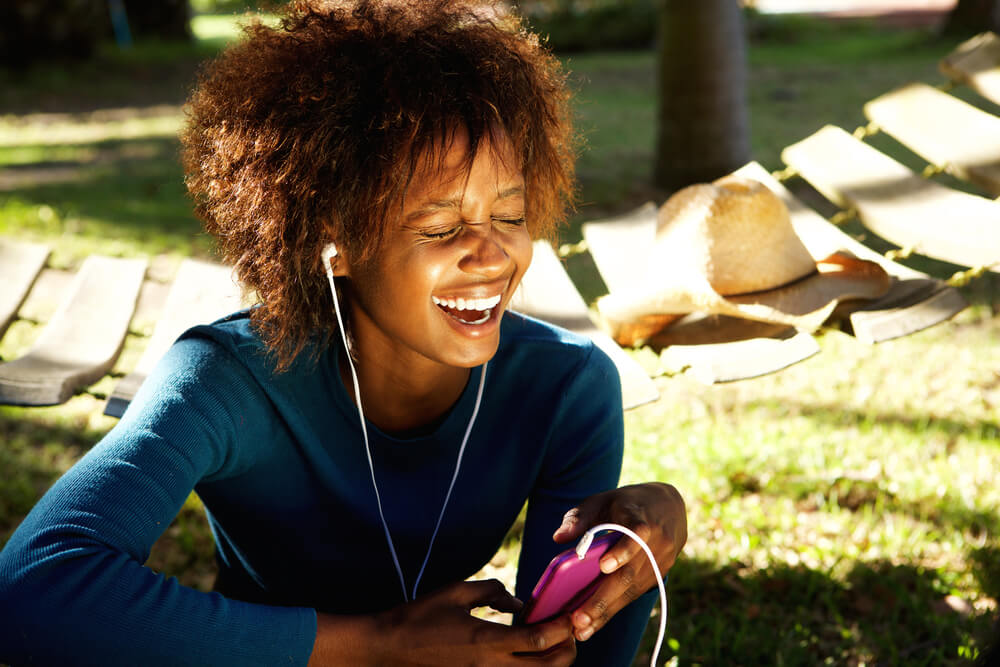 Girl with headphones in laughing