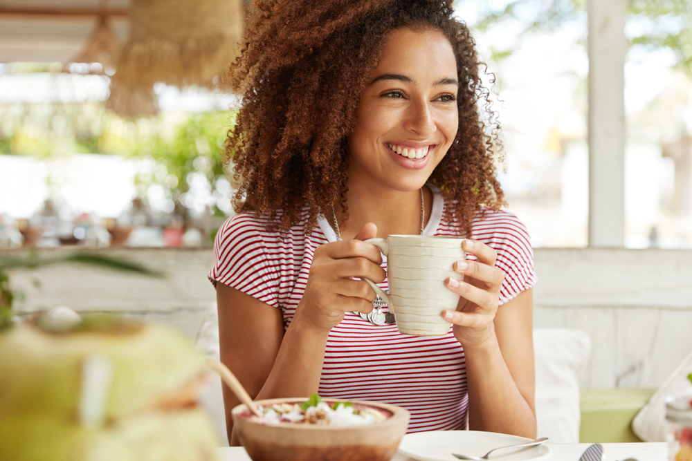Lady with good skin sipping a coffee