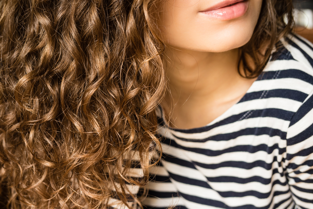 girl with curly hair in stripped shirt