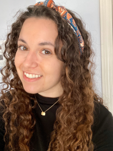 girl with curly hair and head scarf