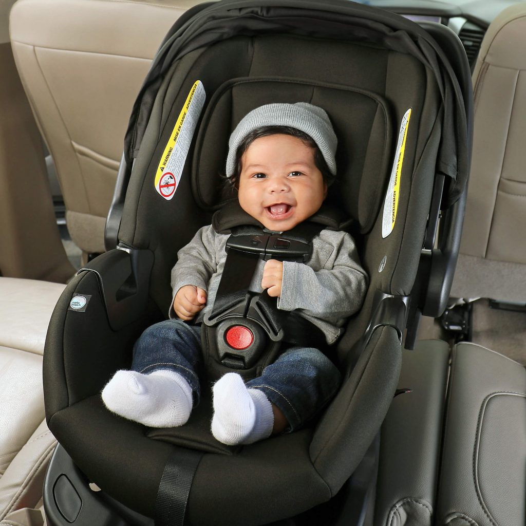 Baby smiling in car seat