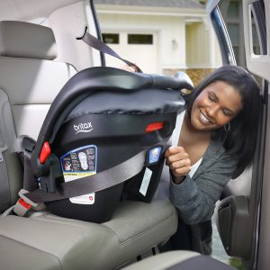 Woman Buckling in a car seat to the back of car