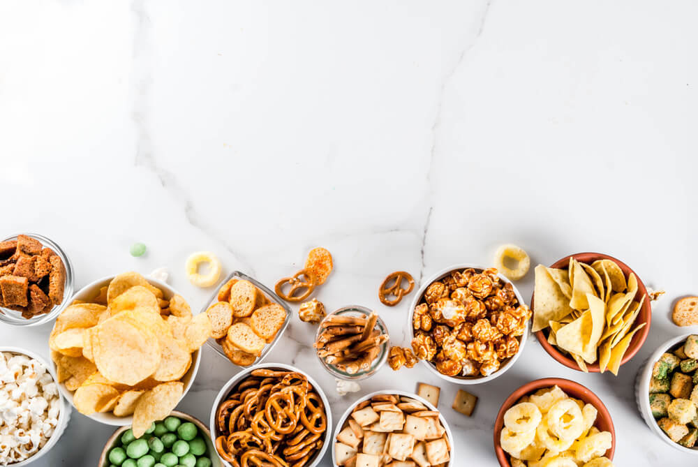 white marble table with snacks in small bowls